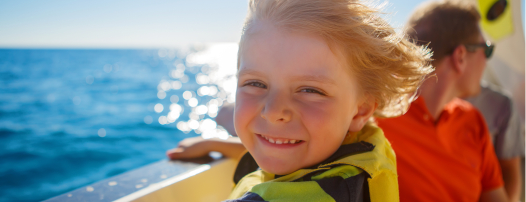 Boy on boat smiling